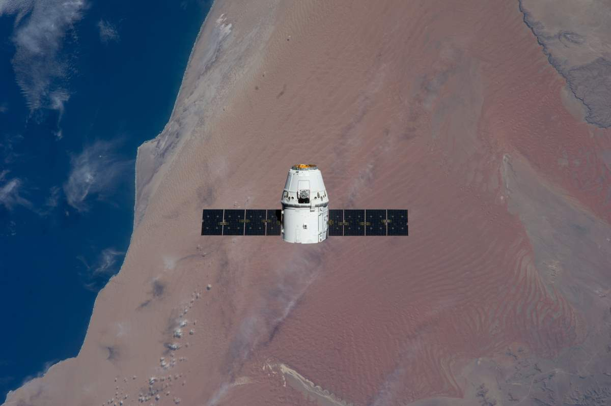 Most Beautiful Earth Images Taken From the International Space Station in 2015: SpaceX Dragon over the Atlantic coast of Namibia