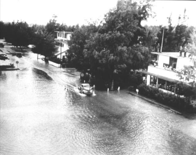 Most Powerful Earthquakes: A Flooded street in Midway Island after 1952 Kamchatka tsunami