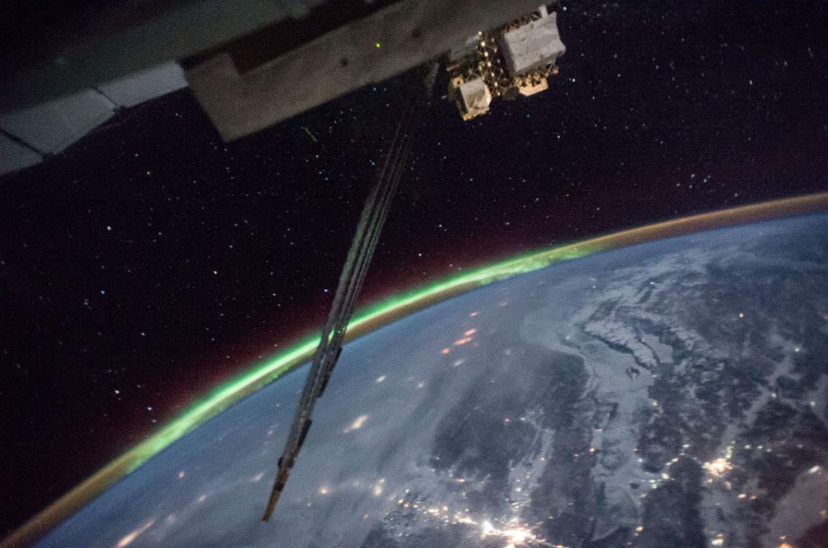 Auroras, Sparkling City Lights, and the Stars. ISS image taken on January 18, 2017