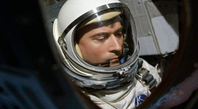 John W. Young is seen through the spacecraft window prior to launch of Gemini-Titan 3 mission