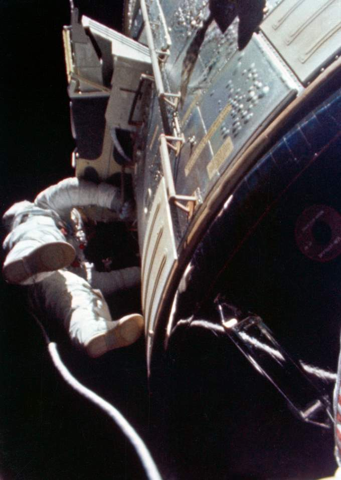 Apollo 15 astronaut Alfred Worden performing humanity's first deep space EVA, August 5, 1971