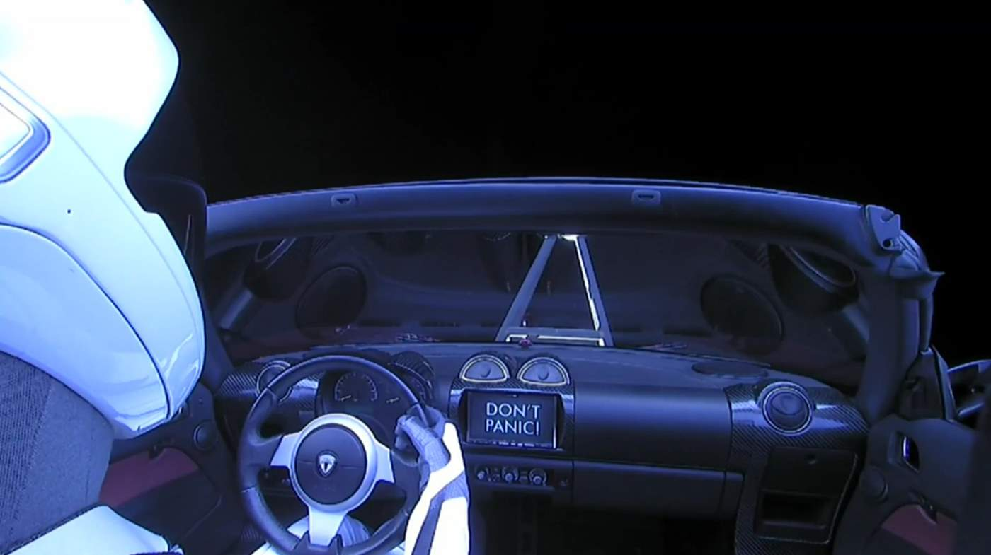 Falcon Heavy Test Flight: Tesla in space. Don't Panic!