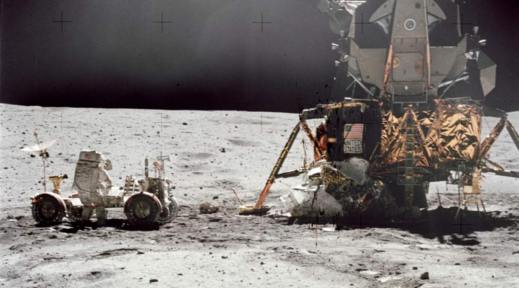 John W. Young, commander of the Apollo 16 lunar landing mission, works at the Lunar Roving Vehicle (LRV)