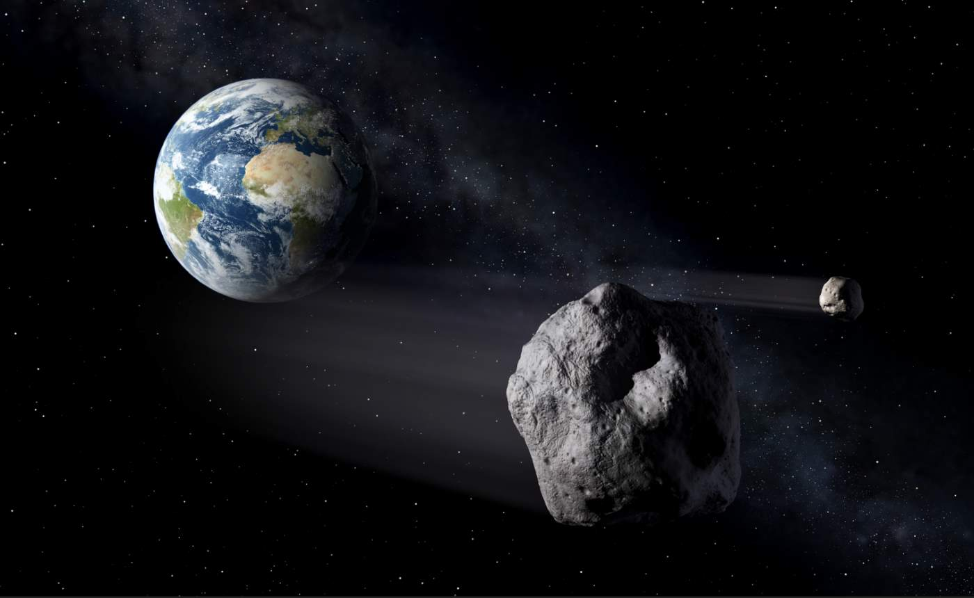 Two asteroids passing Earth