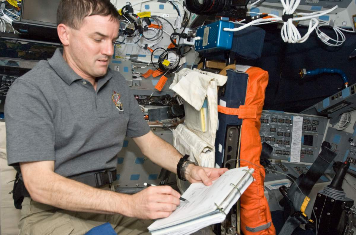 Astronaut using space pen