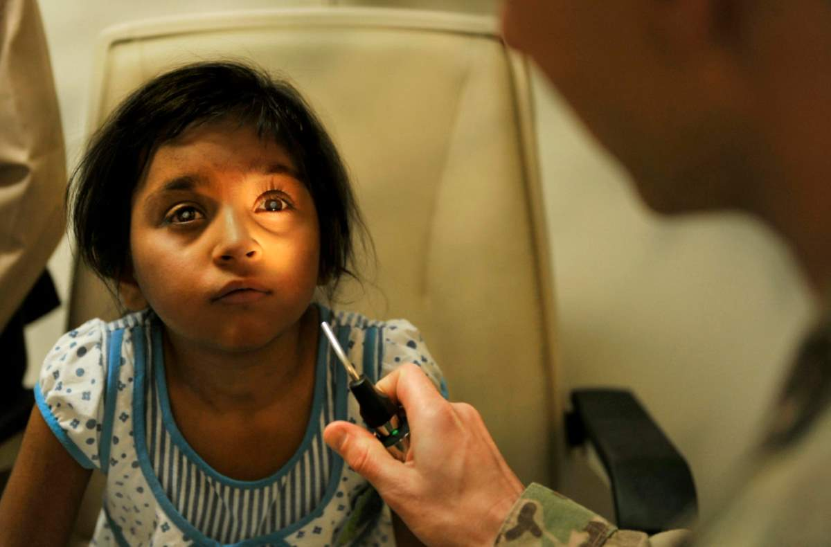 Eye care for an Afghan kid