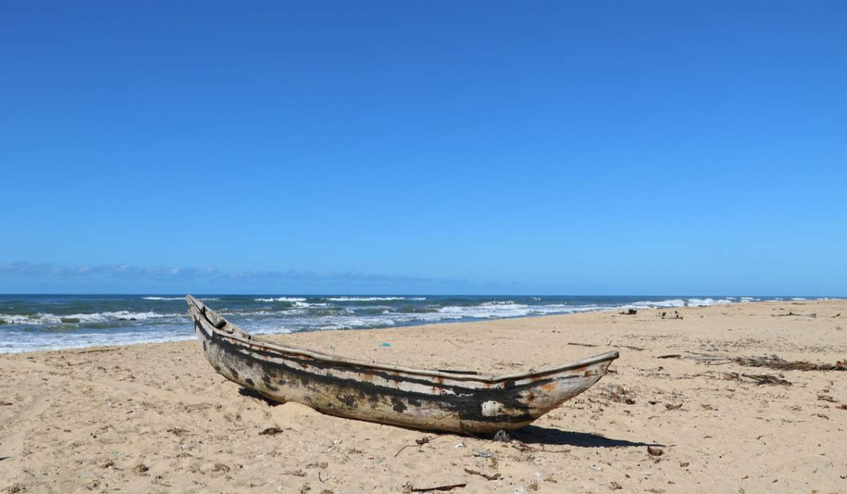 A boat on a sandy beach