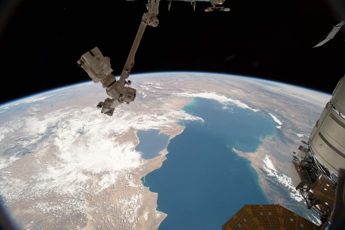 Top 10 Most Beautiful Earth Photos Taken From the International Space Station in 2018: The Canadarm2 and the Caspian Sea. June 21, 2018.