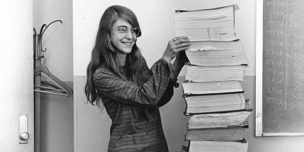 Margaret Hamilton standing next to Apollo 11 Code (cropped image)