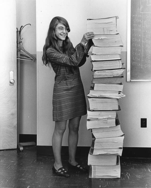 Margaret Hamilton standing next to Apollo 11 Code