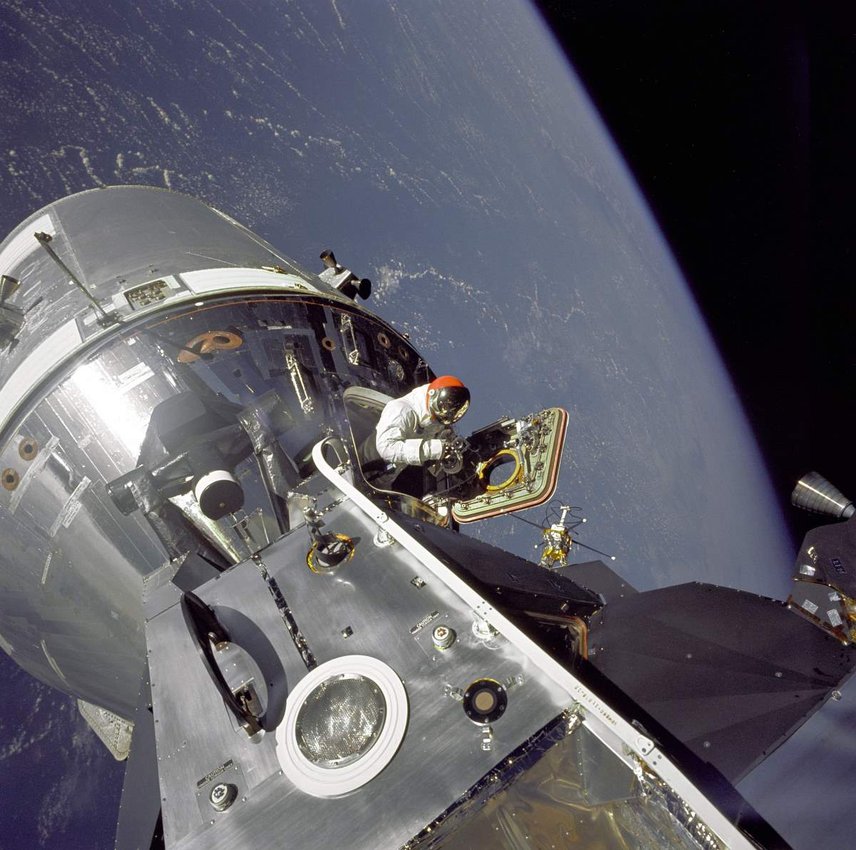 "Astronaut Dave Scott emerges from the Apollo 9 Command Module ""Gumdrop"""