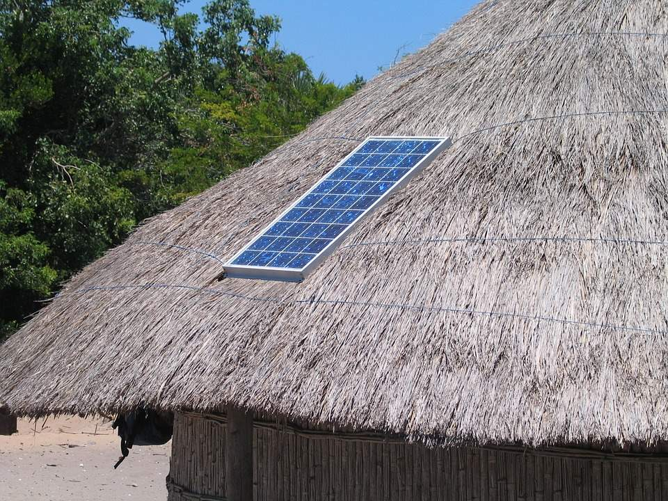 Solar panels atop a roof of a hut