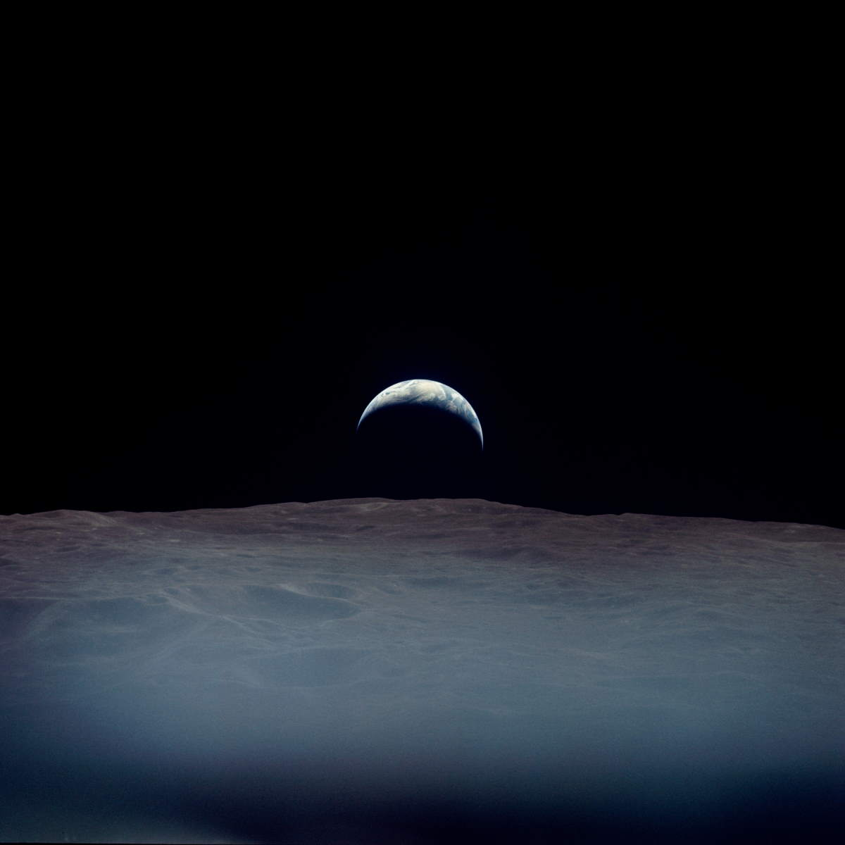 Earth rises just west of Crater Pasteur - Apollo 12 image