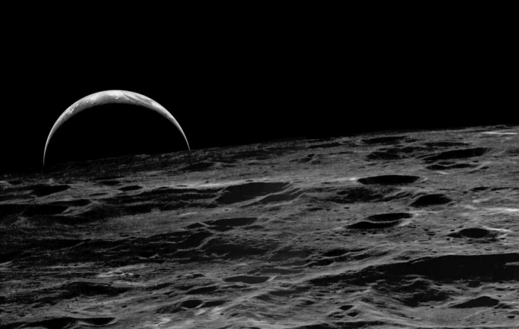 A crescent Earth rising over the Moon