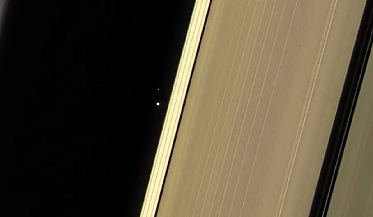 Earth and Moon as seen through Saturn's rings (2017 Cassini Image)
