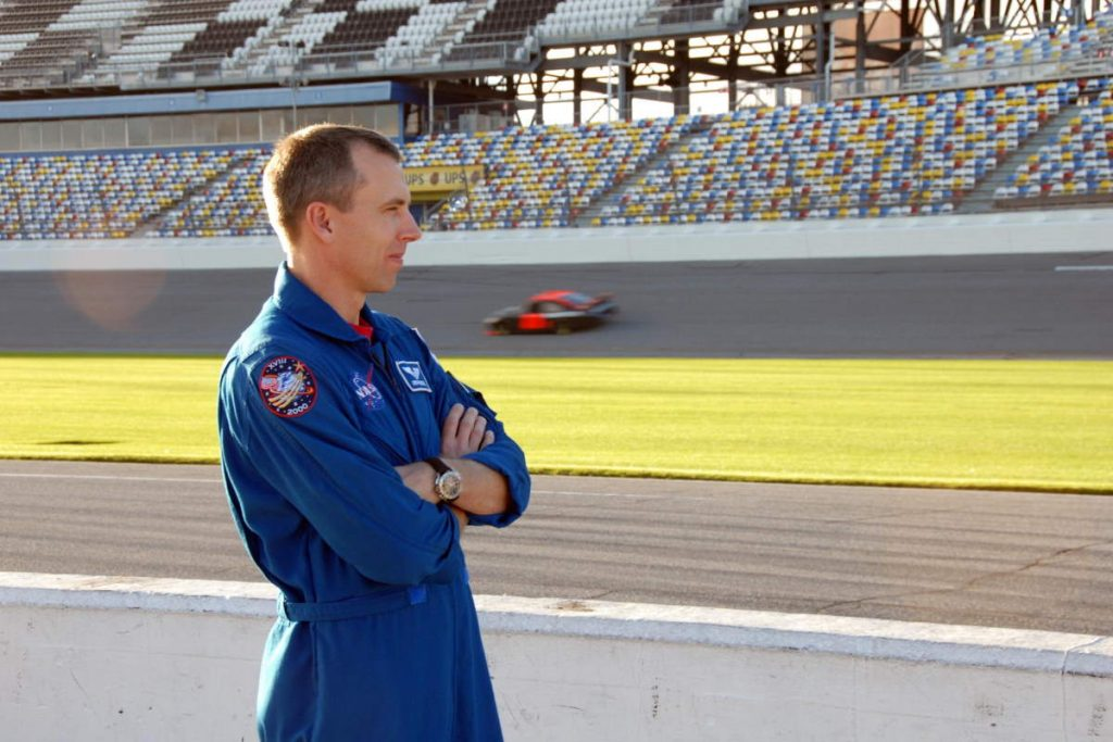 Auto innovations driven by NASA research: Astronaut Andrew Feustel watched cars on the Daytona International Speedway in 2008