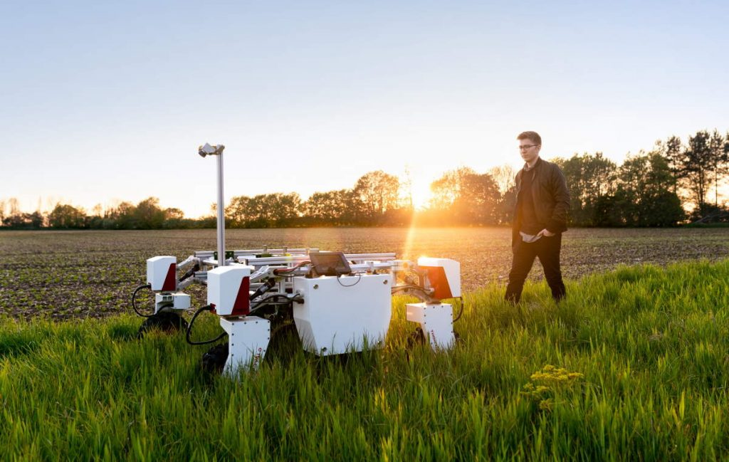 How robotics can revolutionize sustainability? A mechanical engineer with sustainable agricultural robot in field